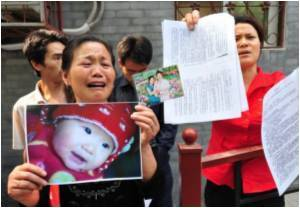 China Imprisons 14 People in Baby Milk Scandal
