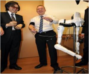 Danish PM Gets into a Japanese Robo-suit