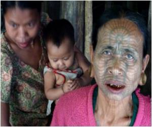 Myanmar's Last Tattooed Women Find Tourists Flocking to Them
