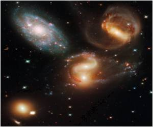 Energy Released by Individual Stars Influences Location of Mass in Galaxies