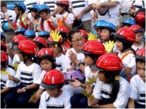 Yeoh Advocates Crash Helmet Use in Vietnam