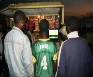 Zambian Village Gathers to View Television for the First Time