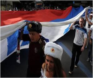 Russians Parade Up Rio Beach, Hopes of World Cup Melting