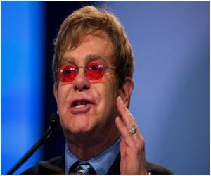 Quoting Elton John, More Love Could End AIDS