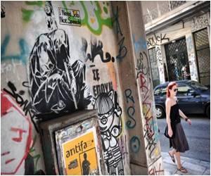 British Street Artist Banksy's Spy Mural Defaced - With Graffiti