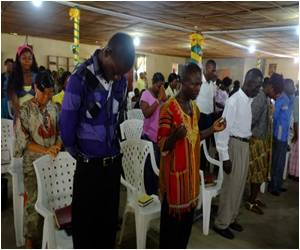 Ebola-Hit Liberians Gather for a Prayer Service
