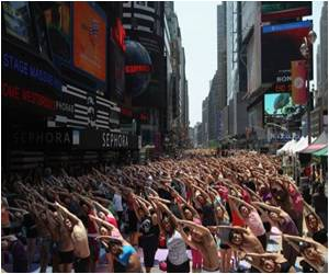 Thousands of Yoga Fans Welcome Summer at Times Square