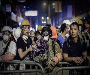 Hong Kong's Pro-Democracy Protesters Add Helmets to Their Umbrellas