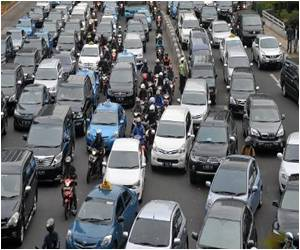 Indonesian Commuters Tweet to Beat Traffic Chaos