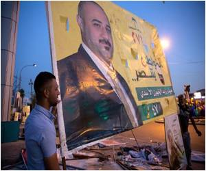 Scavengers Came into Action When Polls Closed in Iraq's Parliamentary Election