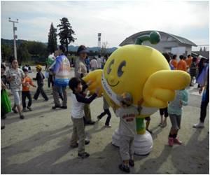 Kids Don Orange for 'Kings Day'