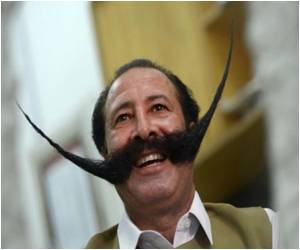 In Pakistan Man Dices With Death for a Moustache