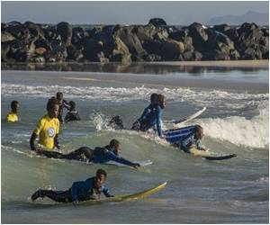 Surfing in South Africa's Shacklands