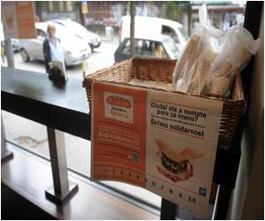 Serbia Residents Buy Meals for Poor