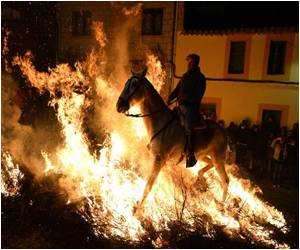 Spanish Town Celebrates Ancient Festival Involving Horses Leaping Through Bonfires