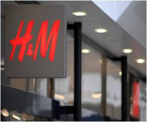 Deeply Tanned Swimwear Model: H&M Apologizes