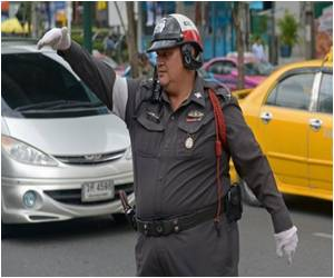 Thailand's Traffic Cops Battle the Bulge By Swaying To Pop Songs