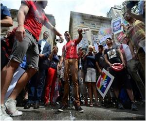 Anti-Gay Laws in Russia See Protesters Dump Vodka Down the Drains in New York