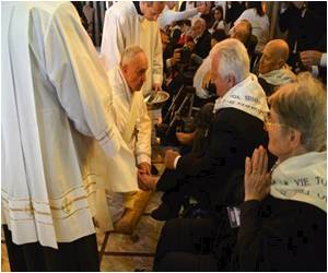 Elderly Muslim Among the People as Pope Washes Feet of Disabled