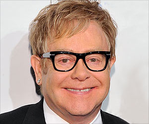 Elton John Scribes an Op-Ed for a Magazine About His Efforts to Fight AIDS
