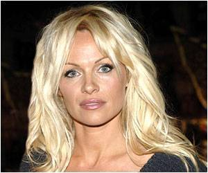 Pamela Anderson's Latest PETA Ad too Hot for Hong Kong Airport
