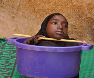 Limbless Teenage Girl Lives In A Plastic Bucket