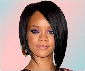Rihanna's Extra Flab Delays Charity Project