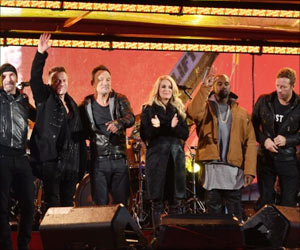 Bruce Springsteen, Chris Martin Fill Bono's Shoes at World AIDS Day Concert