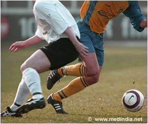 Clenching Left Hand in Pressure Situations Improves Footballer's Success