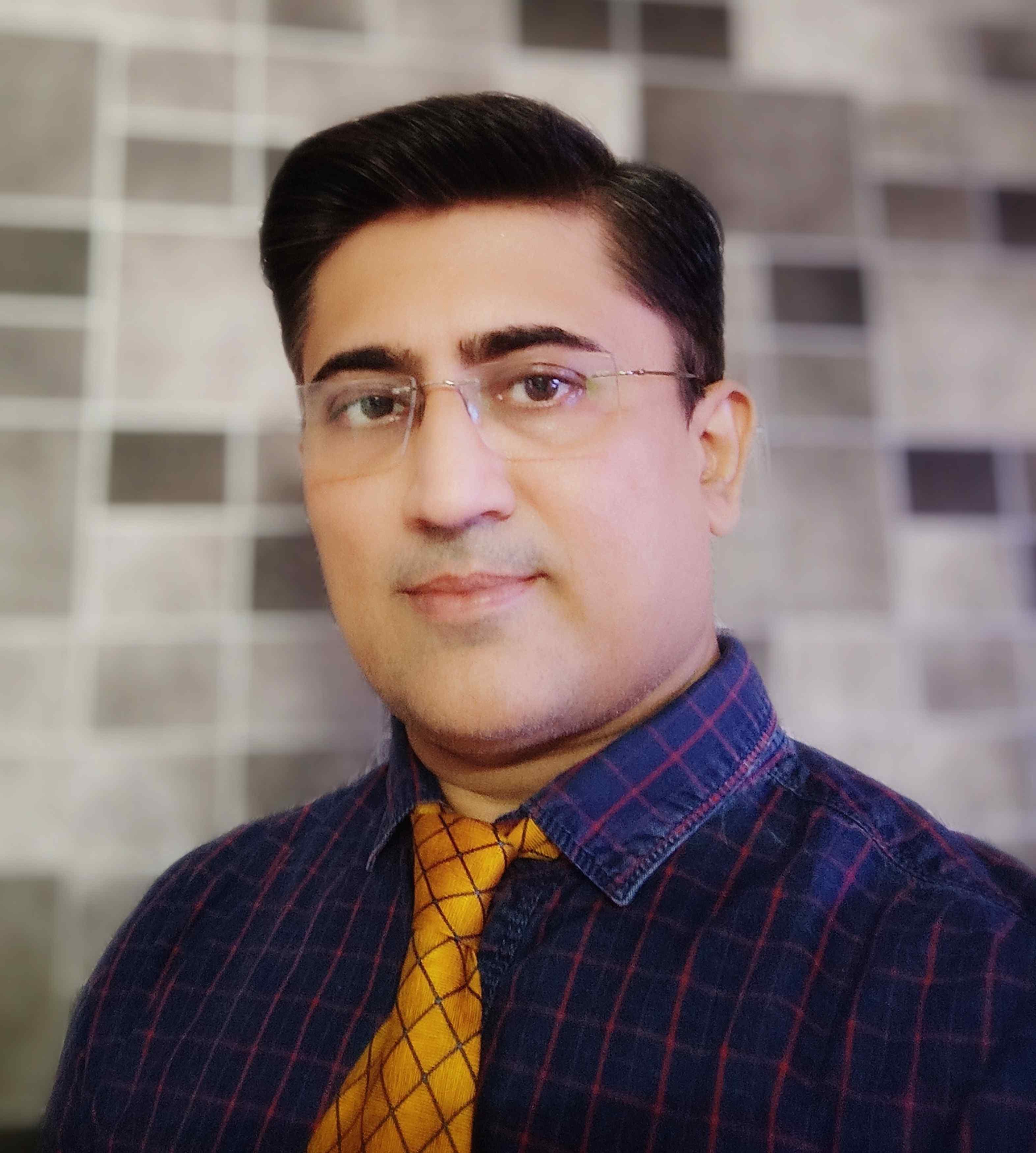 Dr. Mihir Shah